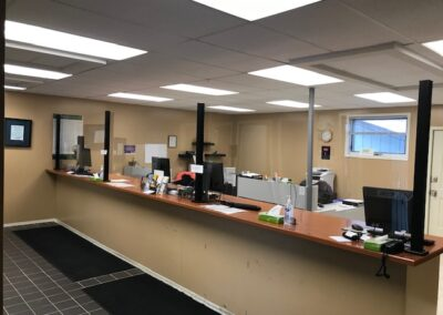 Office multi-desk barrier installation with cutout pass-through